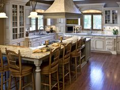 kitchen--Heaven! Love the white cabinets and dark floors and big island.