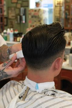 fade Mens Haircut. . . Love the barbers pole tattoo on his thumb