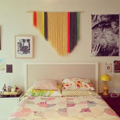 yarn adds pretty wall art to bedroom