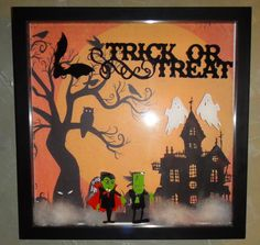 Shadow box from Michaels, 12 X12, Scrapbook paper from K Speciality Paper, Cricut cut outs from Happy Hauntings.  Great tutorial by Cynthia Ryder, titled Trick or Treat Shadow Box.