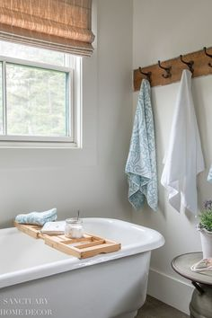 When I'm on vacation, I love to indulge in a nice long soak in the bath, so I want my guests to have the same opportunity. In order to make the idea even more appealing, I added a bamboo tub caddy to the bathtub in our guest bath. I topped it with a jar of lavender bath salts and a copy of a family favorite book to create a spa style experience. Modern Farmhouse Design, Modern Farmhouse Bathroom, Rustic Bathrooms, Farmhouse Style Decorating, Design Your Own Bathroom, Bathroom Design Layout, Bathroom Hacks, Bathroom Inspo, Elegant Homes