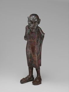 Bronze grotesque Period:Hellenistic Date:2nd century B.C.–1st century A.D. Culture:Greek Medium:Bronze Dimensions:Overall: 4 x 1 1/4 x 7/8 in.