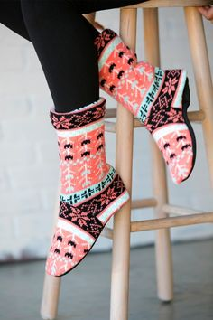 Our cozy Slipper Socks are the perfect accessory you'll want to be sporting around the house this winter! These make great gifts, so pick up a pair for yourself and a few more for family and friends!Styles:Cable Knit -- available in Mocha, Red, and IvoryHearts -- available in Black/Red and White/MintFlower -- available in Pink/BlackSizes:Small/Medium (fits women's shoe sizes 4 - 7)Medium/Large (fits women's shoe sizes 8 - 10)100% acrylic