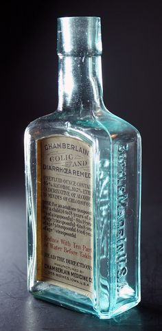 Chamberlain's Colic and Diarrhœa Remedy - Aqua, rectangular, molded tapered lip, 5 5/16in (135mm) tall. Embossing: CHAMBERLAIN'S COLIC AND DIARRHŒA REMEDY (back panel), CHAMBERLAIN (side panel), BOTTLE MADE IN U.S.A (other side panel), 2 (on base), label on front panel - c1906 or so.