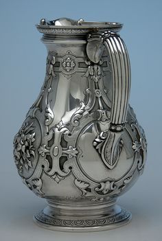 William Gale for Tiffany & Co Antique Sterling Silver Pitcher, c. 1850's    Bold decoration and wonderful design combine to make this pitcher an exquisite example of early Tiffany silver made by William Gale.     Attached at the side is a c-shaped reeded handle with acanthus leaf terminals.  Chased leaves decorate the spreading, pedestal foot and the underside of the top rim.  Ornamenting the body is boldly executed renaissance inspired strap-work with fine engraving.  Incorporated into this…