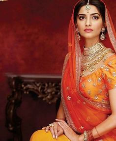 The incomparable #sonamkapoor dressed as a gorgeous #bride. #Love the rich #orange and #yellow along with the beautiful #wedding #jewelry. Let us know if you know additional credits for this image. #indianweddings