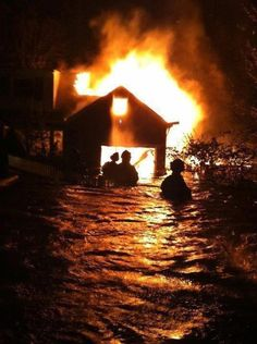 NYC. Sandy Hurricane. October 30, 2012. Fire at Breezy Point, Queens.