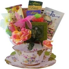 This gift is presented in a gift bag tote that looks like a real tea cup. The tote is very realistic looking, but is NOT a real tea cup.