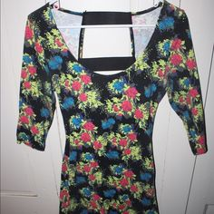 Backless dress with fluorescent floral design This dress is great for a night out!! Glows like crazy in UV lighting, very comfortable and form fitting. Charlotte Russe Dresses Mini