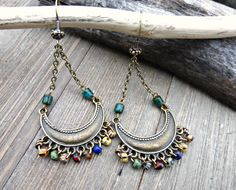 Boho me. Wire wrapped Czech glass, chain, pendants in bronze metal earrings. #jewelry #jewellery #handmade #bohemian #fashion #accessories #bohemianjewelry Handmade, handcrafted artisan, beaded jewelry, jewellery. Boho, Bohemian, indie, Victorian, Bridal Andria Bieber Designs.