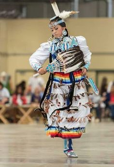 Jingle Dress is a Native American Powwow dance performed by women. The regalia is elaborately ornamented; the metal cones create percussive sound as the dancer moves.