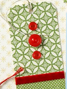 Buttoned Up  Glue two decorative papers on a tag and hide the seam with velvet ribbon. Finish it by hot-gluing on decorative buttons or beads.