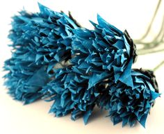 Peacock or teal blue origami folded paper made into flowers.