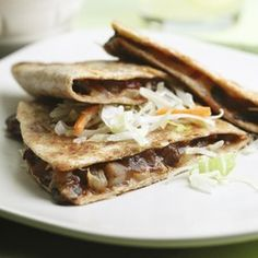 This smoky mushroom-filled quesadilla is reminiscent of pulled pork. A touch of chipotle chile pepper adds extra heat. Serve with coleslaw and guacamole.