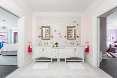 White and pink Jack and Jill girl's bathroom is illuminated by Kohler Purist Single Sconces mounted on white mosaic marble grid tiles on either side of beveled beaded mirrors fixed above a white dual washstand. Kid Bathroom Decor, Childrens Bathroom, Shared Bathroom, Bathroom Layout, Master Bathroom, Bathroom Designs, Bathroom Furniture, Bathroom Small, Bathroom Plants
