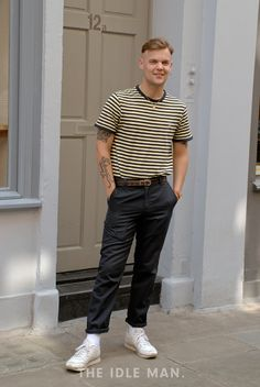 Men's street style | Sailor Vibes - Embrace the nautical vibes with this striped t-shirt and some rolled up navy trousers with some white trainers.| Shop the look at The Idle Man
