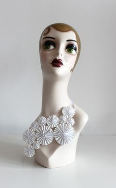 I love the bust-thingy the paper jewelry is on!   Elena Salmistraro Alla paper jewelry
