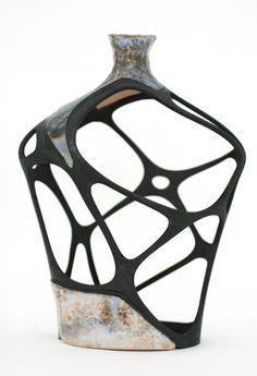 A digitally restored broken vase, glazed ceramic, SLS nylon element, epoxy glue and black spray paint, 2010. (© Amit Zoran) via archdaily