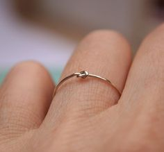 I've been looking everywhere for this ring!!!   Tiny Knot Ring in Sterling Silver by indiaylaluna on Etsy, $26.00
