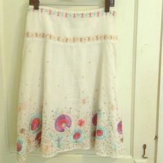 """Cotton Embroidered Skirt Cotton skirt. A-line cut that hits at be knees on me- I'm 5'5"""". Has a linen look and texture to it. Around the waist is light blue and coral pink- then a nude and beige detail. The bottom is beautiful- the colors are perfect for spring! Dry cleaned and ready to go! French Connection Skirts A-Line or Full"""