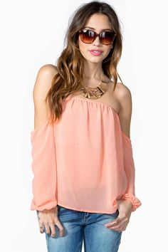 An easy, breezy blouse featuring an elasticized off-shoulder neck and long sleeves. Finished hem. Sheer.