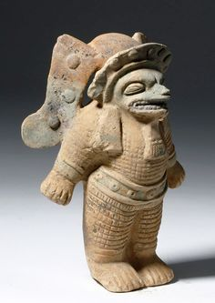 Pre-Columbian, Ecuador, Jama Coaque (Jamacoaque) culture, ca. 500 CE. An animated example of a shaman, standing with its hands thrown out to its sides. The figure's features are transformed, wild, and animalian. It wears a headdress, a loincloth, a long necklace, a nose ornament, armbands and anklets. The body is covered in what appears to be armor and the feet look almost avian. This was a hollow, mold-made figure, and a great deal of the original blue and yellow pigment - some of the most…