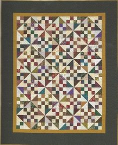 """Yee Haw! This quilt pattern is totally scrappy, with an overall pattern created by a wide variety of lights, darks, textures, and values. The fabrics do not have to """"match"""" for this to be a wonderful quilt! Finished Size: 66"""" x 82"""""""