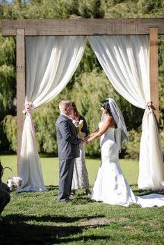 Beautiful summer wedding under a DIY ceremony arbor.   #WineCountryWedding #OlympiasValley #AmyBridgesEvents