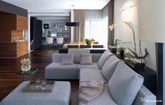 Eleganckie wnętrze domu z dużą sofą Protos, Perobell i lampą Plis, Vibia. www.bartekwlodarczyk.com