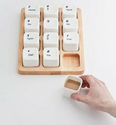Keyboard Coffee Cups by E Square, inspired by the Apple computer keyboard