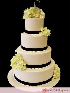 wedding cake with ribbon and hydrangea  I love this just with a smoother cascade of flowers.