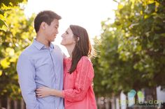 She pops in coral, he's handsome in blue stripes; we love everything about this downtown Charleston SC engagement shoot!