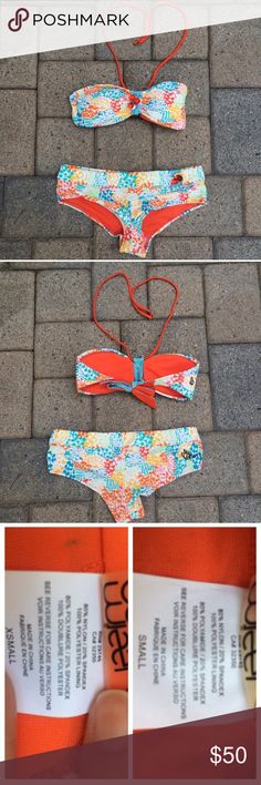 NWOT Volcom retro swim set New without tags, bottom still has its hygienic liner. Bandeau top and cheeky shorts bottoms. Light removable padding in the top as well as halter strap. Top is XS and bottoms are S. Volcom Swim Bikinis