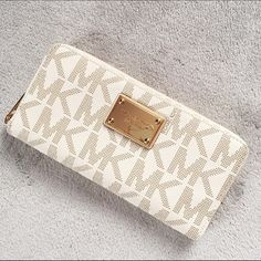 Michael Kors Continental Wallet Michael Kors Continental Wallet in vanilla. The wallet is in like new condition having no flaws, no scratches on the hardware, stains, or tears. The wallet features 8 card slots, 2 cash slots, and a zippered coin slot. 100% Authentic.                                ❌NO TRADES❌ Michael Kors Bags Wallets