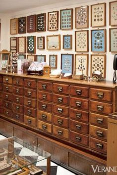 Framed buttons on the wall. Buttons sorted in the drawers of this stunning cabinet probably!  Via Veranda.com