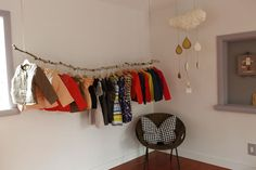 Love this idea for hanging clothing