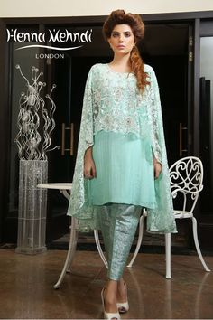 Designer Indian & Pakistani Mint Net Embroidered Cape Outfit available in Salwar Trousers, Embroidered Trousers and Bootcut trousers. Designed in London UK. Free delivery over £75. Mint net cape with pearl and diamante embroidery on front of cape. Included is a mint cotton net inner shirt. Available with mint jamavaar trousers or cigarette trousers with pearl buttons on side. Please note delivery time is approximately 4-6 weeks. There is no exchange or refund̴Ì_on this product as this...