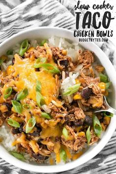 """Slow Cooker Taco Chicken Bowls are the ultimate """"set it and forget it"""" easy weeknight meal that the whole family will love. BudgetBytes.com #slowcooker #crockpot Slow Cooker Tacos, Slow Cooker Chicken, Slow Cooker Recipes, Crockpot Recipes, Chicken Recipes, Cooking Recipes, Healthy Recipes, Cheap Recipes, Delicious Recipes"""