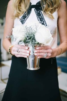 Amanda fills our Mint Julep Cup with White O'Hara garden roses and Blue Ice Cedar for a charming winter arrangement | Love, Reese Blog | Draper James