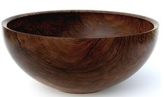 I love the look of a wooden bowl. Fill it with a couple of skeins of pretty yarn and put it on a shelf in the living room...or for a kitchen/dining room, fill it it faux moss or fruit. or artichokes.