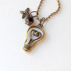 Light Bulb Pendant Antique Bronze 3D Fashion Teens Necklace Bumble Bee Red Bead Steampunk Trendy. $26.00, via Etsy.