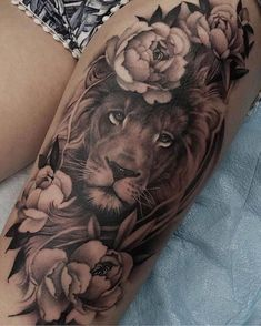 lion tattoo lion head, surrounded by flowers, leg tattoos for women, black and white shorts Lion Tattoo On Thigh, Lion Tattoo Sleeves, Lion Head Tattoos, Leg Sleeve Tattoo, Tiger Tattoo, Body Art Tattoos, Elephant Tattoo On Thigh, Lion Tattoo On Back, Lion Woman Tattoo