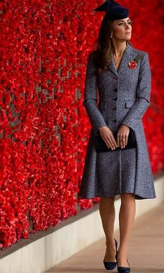 The Duchess of Cambridge wore a navy tweed coat dress by Michael Kors for the Anzac Day memorial service during her royal tour of Australia in 2014.