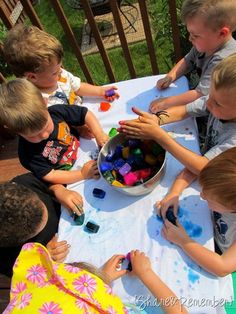 Painting With Ice Cubes! Freeze watercolors into cubes and then give to your kids to paint with on cloth. Fun and a good way to keep cool!