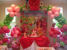 Strawberry shortcake inspired balloon arch