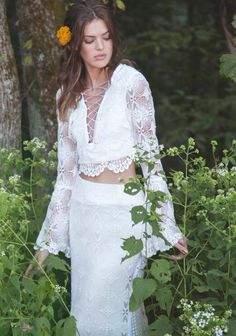 The ivory two-piece Fleetwood gown is made with three different complimentary crochet laces. Top portion features lace up front detailing