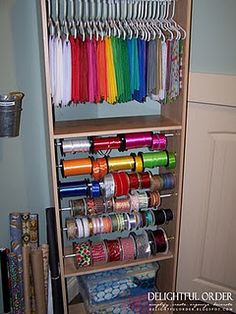 Hang tissue paper on kid-size hangers. Ribbons on dowels. Use mud room cabinet
