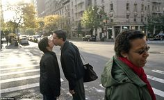 Morning kiss: This couple looks as though they're saying goodbye before heading off to work