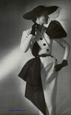 I love this suit by Jacques Fath, 1951.........it takes power dressing to an…