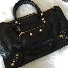 """NWT Balenciaga Black Leather Work Bag w/Giant GHW 100% Auth Balenciaga Black Work Bag with Giant Gold Hardware. Brand new never used. In pristine condition.  Beautiful luxurious distressed leather with gorgeous sheen. Bright and shiny gold tone hardware. Made in Italy. Measures at approx. 18""""L x 11""""H x 7.5""""W. Handle drop approx. 4.5"""". This is the work bag NOT city so there is no shoulder strap. Add'l pics avail to serious buyer. Sorry no trade. Balenciaga Bags"""